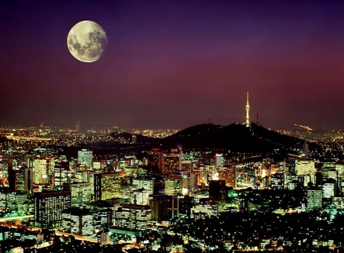 Moon rising over Seoul, South Korea